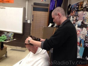 Chris shaving the head of his dad, Craig DeRogatis
