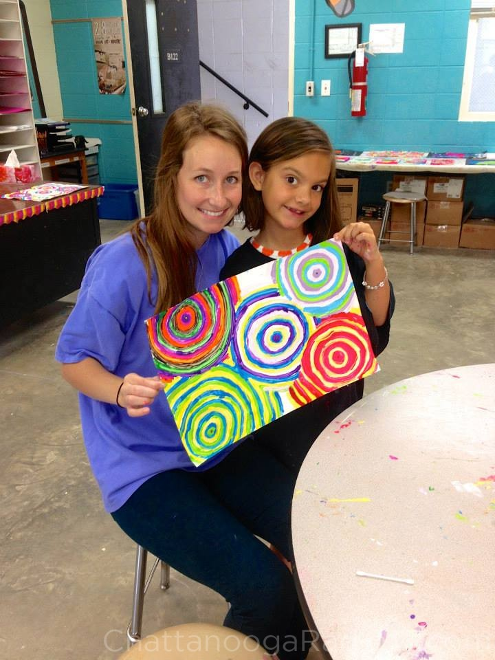 Brittany Huber, with an art student in 2013