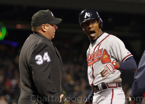 Umpire Sam Holbrook and B.J. Upton have a friendly disagreement about the strike zone.