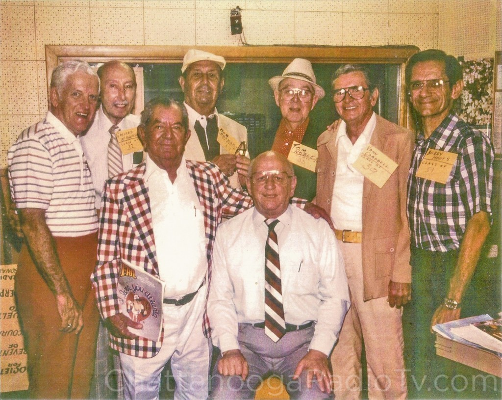 Luther is seated, along with (L-R) Ernie Feagans, Gaylord McPherson, Abe Zarzour, Bob Bosworth, Tom Nobles, Vann Campbell, and Buddy Houts.