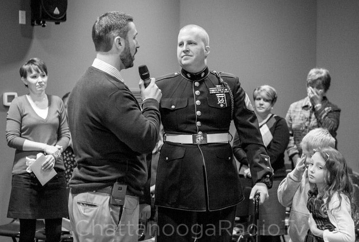 Calvary Baptist youth minister Aaron McGuirt recognizes Officer Nathan Rogers