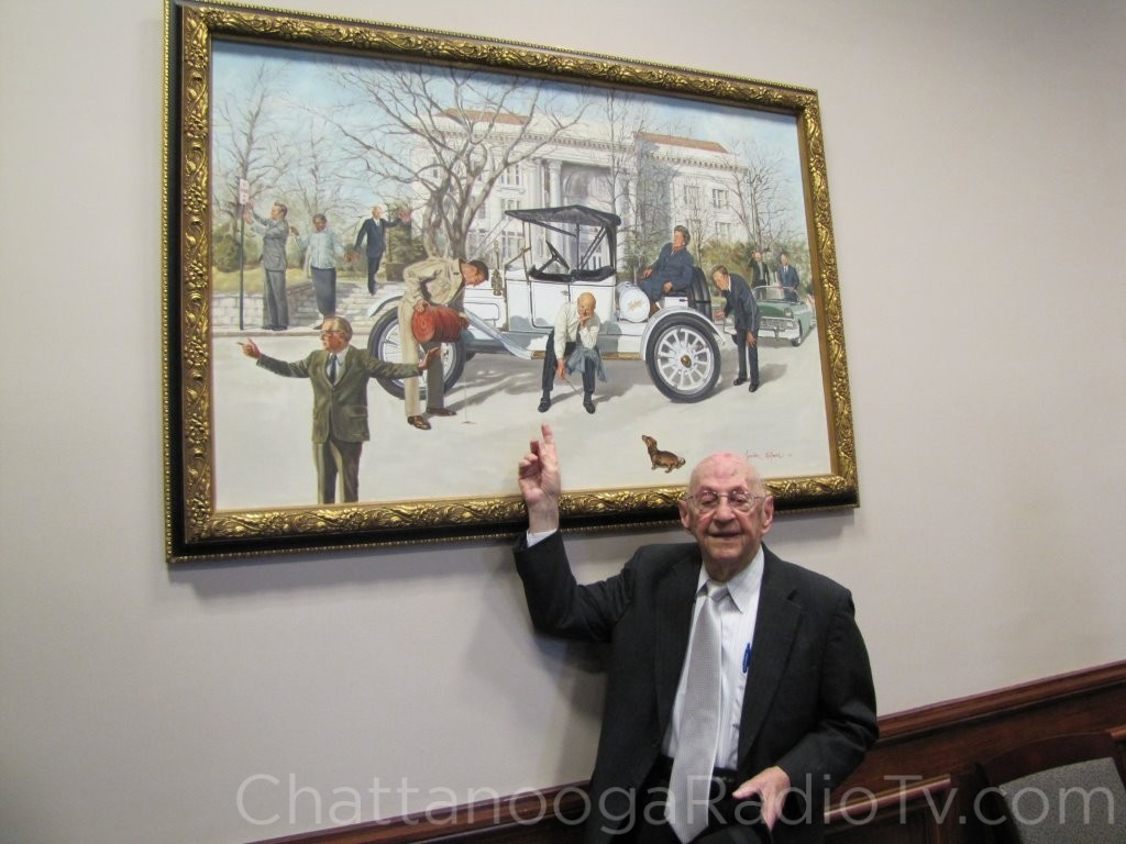 Luther in 2013, pointing himself out in the Gordon Wetmore painting in the Hamilton County Commission meeting room.
