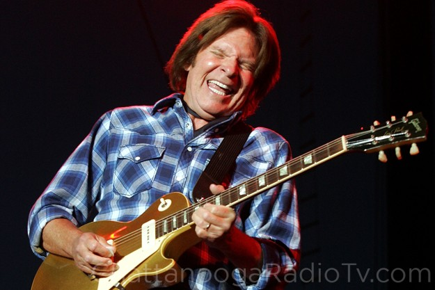 John Fogerty, singing about those happy creatures